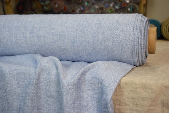 Pure 100% linen fabric Brava Blue Allure 225gsm. Light soft blue-white melange, denim weave. Middle weight, dense, washed-softened.