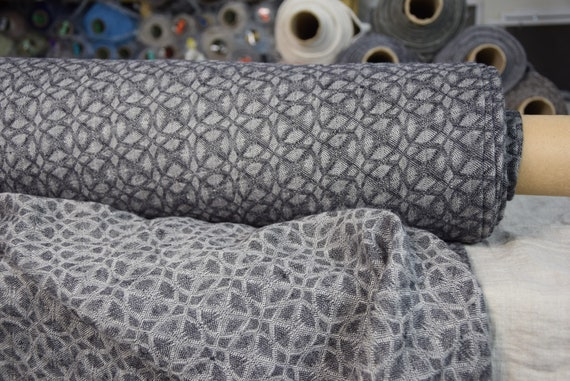 Pure 100% linen fabric Nora Black 210gsm. Small abstract-floral jacquard pattern woven from black and undyed flax colors. Washed-softened.