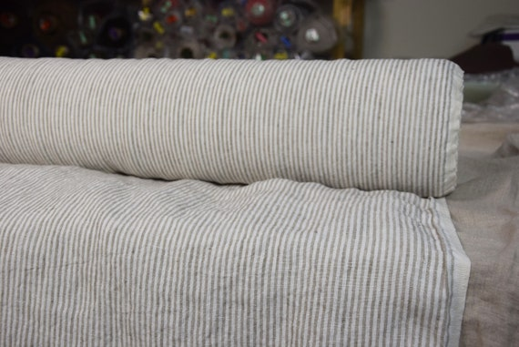 Pure 100% linen fabric Elba Beige Candy Stripes 200gsm. White/beige 2.5mm stripes. Washed-softened, naturally wrinkled.