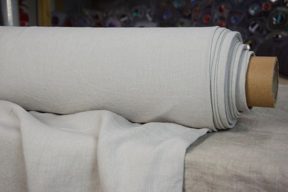 Pure 100% linen fabric Nata Nimbus Gray 250gsm. Very pale quiet gray, coolish undertone. Quite heavy, softened-washed, densely woven.