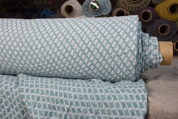 Pure linen fabric Bruma Aqua 260gsm. Fluffy double-faced, two-sided. Diamond (rhombus) pattern in white/greenish. Washed-softened.