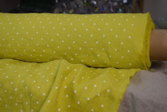 Pure 100% linen fabric Gloria Chartreuse Polka Dot 190gsm. Yellow-green color with small white dots. Washed-softened.