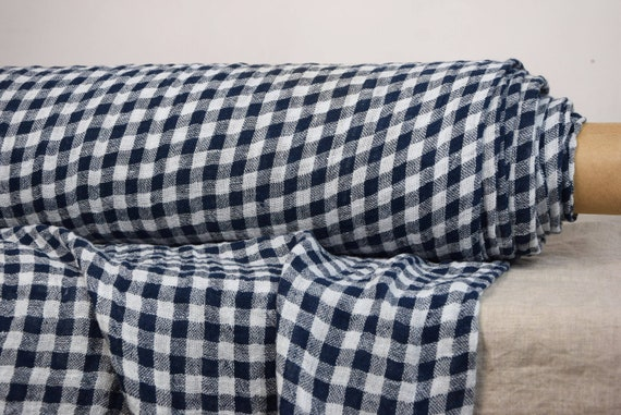 Linen fabric Pura Blue Gingham. Thin semi-sheer gauze. 100% linen 110gsm. White and blue-black 10mm checks, gingham. Washed-softened.