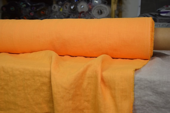 Pure 100% linen fabric Gloria Juicy Orange 190gsm(5.60oz/yd2). Bright vibrant orange-yellow. Middle weight, densely woven, washed-softened.
