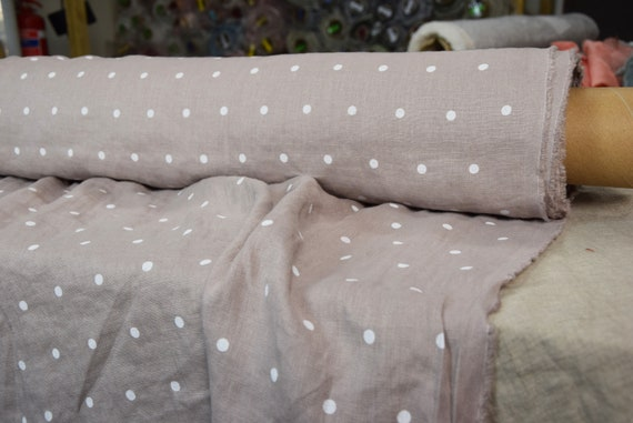 Pure 100% linen fabric Gloria Adobe Rose Polka Dot 190gsm. White dots on muted pinkish-gray background. Washed-softened, densely woven.
