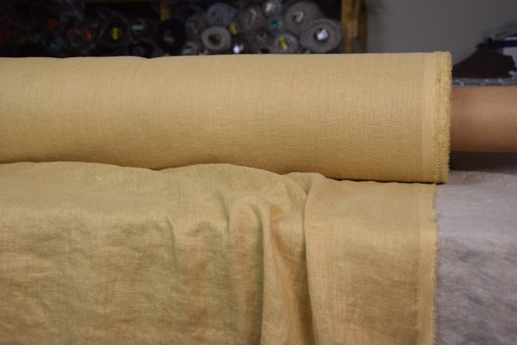 Very thin 95gsm semi-sheer pure 100% linen fabric Serena Laguna Yellow 95gsm. Muted, not bright mellow yellow. Washed-softened.