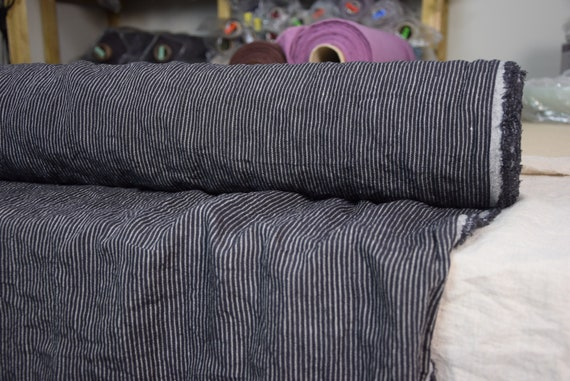 100% linen fabric Elba Stone Black Pinstripes 200gsm. Black/Undyed flax stripes. Naturally wrinkled texture. Washed-softened.