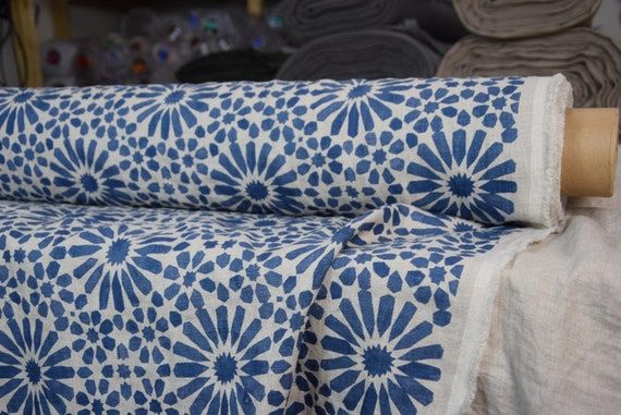 Pure 100% linen fabric Gloria Blue Flowers 200gsm. Blue pattern on undyed flax background. Washed-softened.