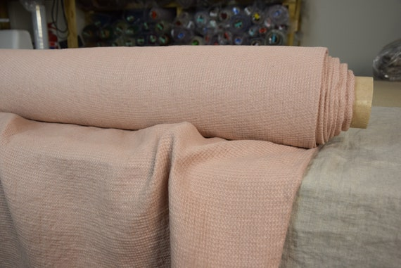 100% pure linen waffle fabric Tutela Apricot Rose 230gsm. Pink pastel color with an apricot-orange hint. Softened-washed.
