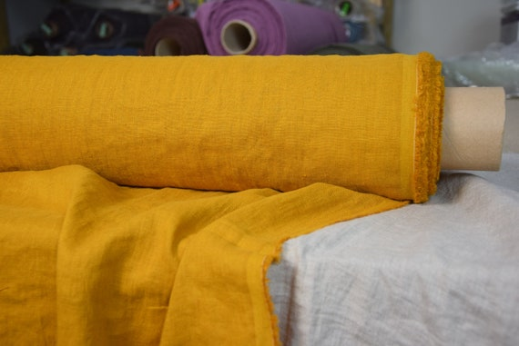 Pure 100% linen fabric Gloria Curcumin Yellow 190gsm. Bright spicy yellow with a slight brown/orange subtone. Washed-softened.