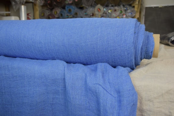 Linen fabric Pura Brazilian Blue. Thin semi-sheer gauze. 100% linen 110gsm. Open weave (loosely woven). Washed-softened.