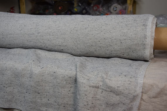 Linen/viscose/silk fabric Seda Boucle Natural Melange 150gsm. Melange with black-gray boucle loops, undyed flax color. Washed-softened.