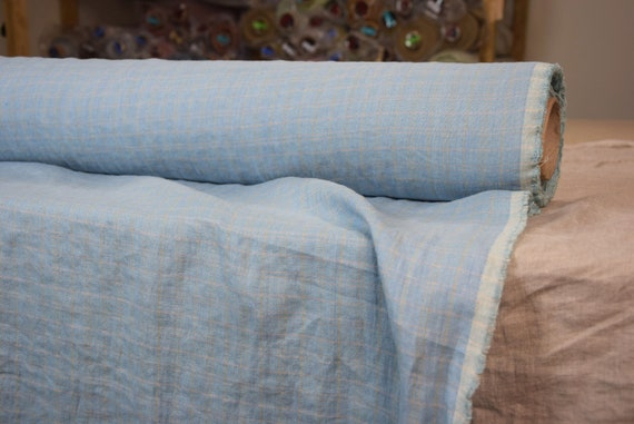 Pure 100% linen fabric 190gsm. Blue with soft inconspicuous checks. Middle weight, dense, washed-softened.