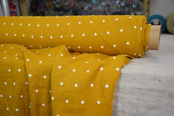 Pure 100% linen fabric Gloria Curcumin Yellow Polka Dot 190gsm. White dots on bright yellow (turmeric tint) background. Washed-softened.