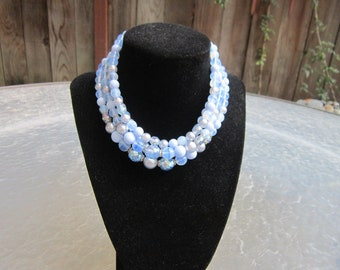Vintage four strand blue glass bead necklace made in Germany - estate jewelry