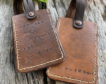 Personalized hand stitched leather luggage tags.