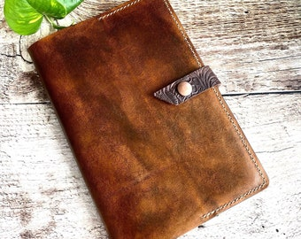 Beautiful hand stitched and stained journal with Herman Oak veg tan leather and lined notebook.