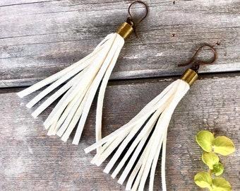 White leather tassel earrings.