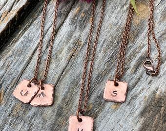 Personalized oxidized copper pendant with copper chain.