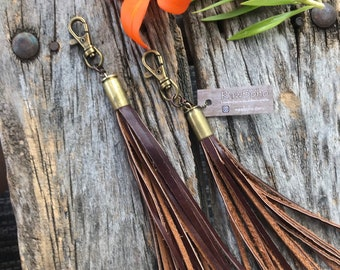 Leather tassel keychain with bullet casing.