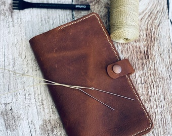 Stone oiled leather small leather journal with snap closure and pen holder.