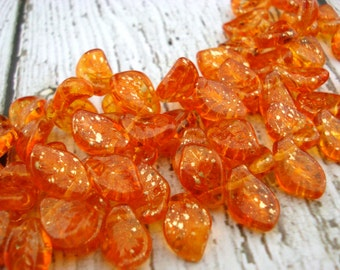 SUNSHINE DUST COATED Leaves Czech Pressed Glass Tangerine Orange Dusted with Gold Leaf Beads Qty 25 14 X 9 mm