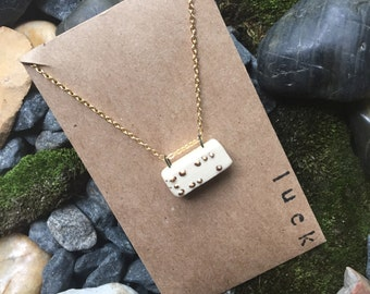 """Braille necklace in """"luck"""""""