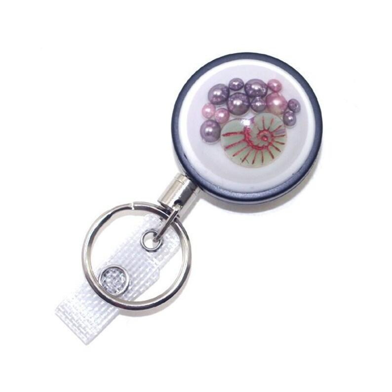 ba42eece58cd7c Nautilus Shell Badge Holder Decorative Badge Crystal Pearl