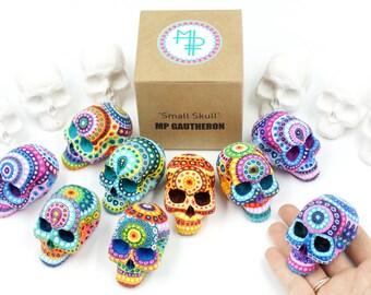 One small plaster skull on demand