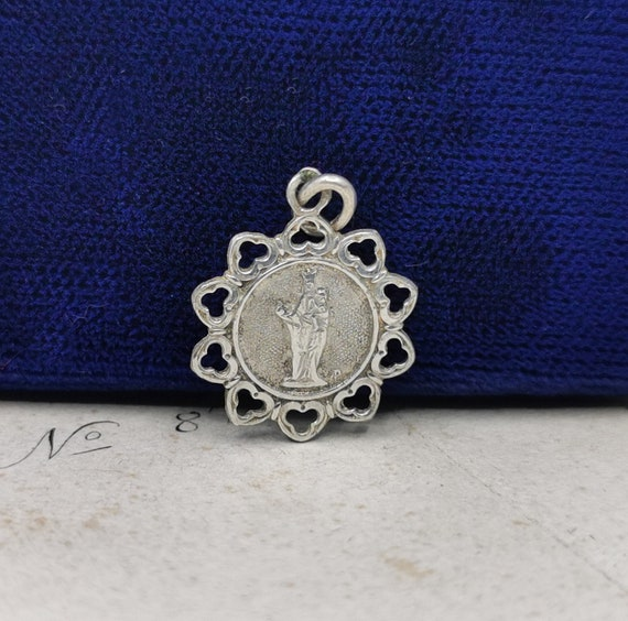 Antique Virgin Mary charm necklace .
