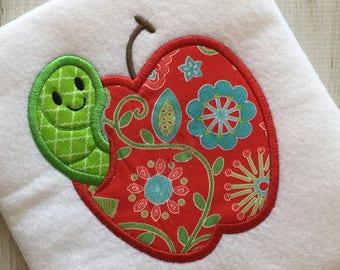 Worm in apple appliqué machine embroidery design