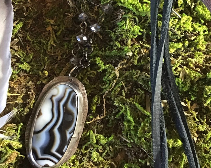Stunning black and white agate set in sterling with vintage inspired crystal chain and black leather,easy over the head styling,cowgirl