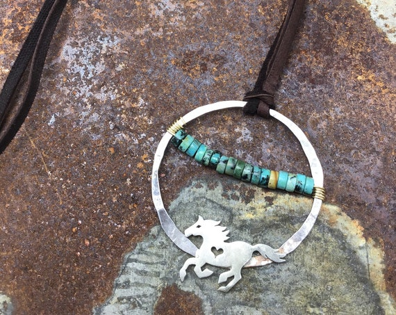 Running free rustic horse necklace with turquoise in center of large hammered sterling hoop, soft chocolate brown leather over head style
