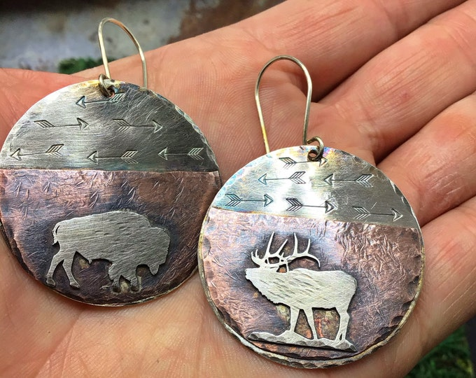 Into the great unknown earrings by Weathered Soul jewelry, elk and roaming buffalo make up these artisan beauties