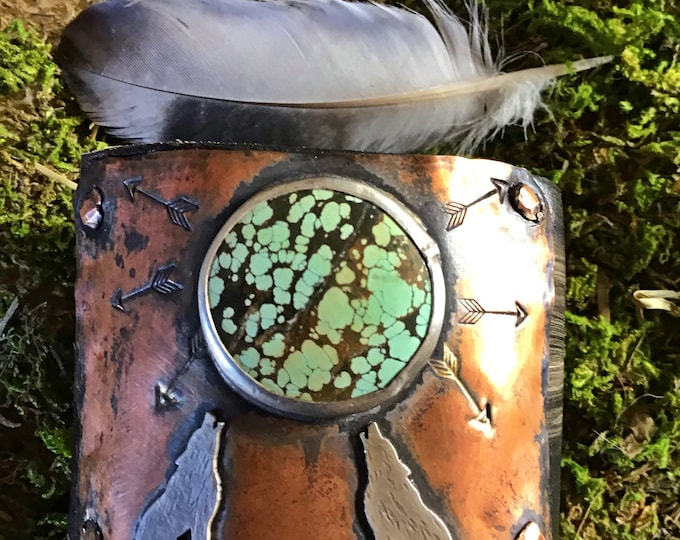 Howling at the moon rendezvous leather and copper cuff bracelet by Weathered Soul, arrow embossed on distressed black leather ,snap close