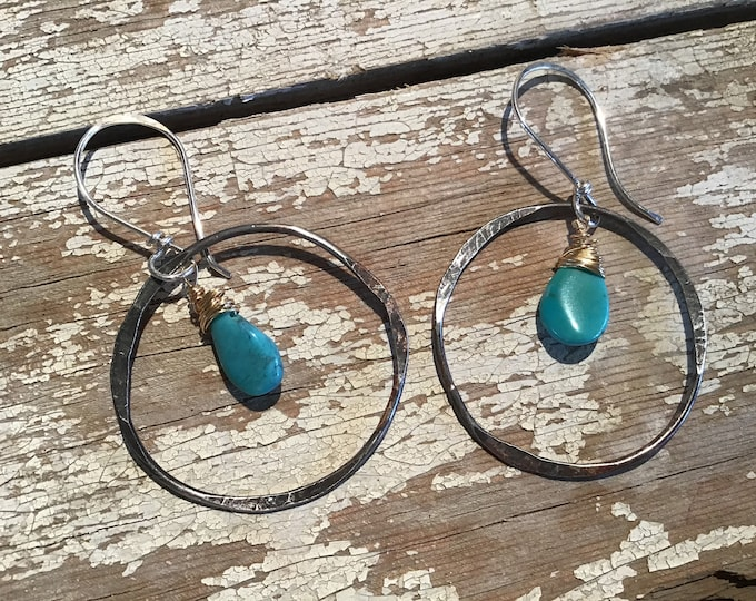 Back to the basics hammered hoops with real turquoise teardrop dangling from the center, Sundance style at far less price, quality, USA