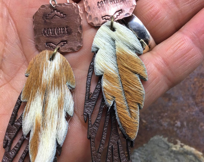 Cowgirl up with these hide on leather feather earrings with copper tag that says cowgirl on it, sterling ear wires, western jewelry