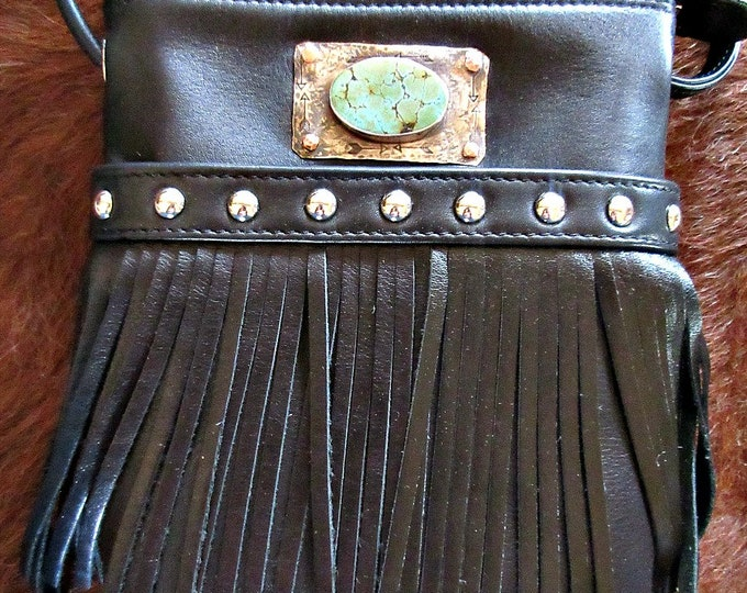 What a stud bag with fringe by Weathered Soul, leather bag with sterling silver and turquoise set stone riveted to bag, cross body styling
