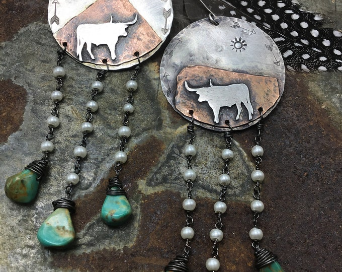 Longhorn stand off earrings by Weathered Soul, artisan jewelry with a turquoise moon with arrows embossed, cowgirl, western style