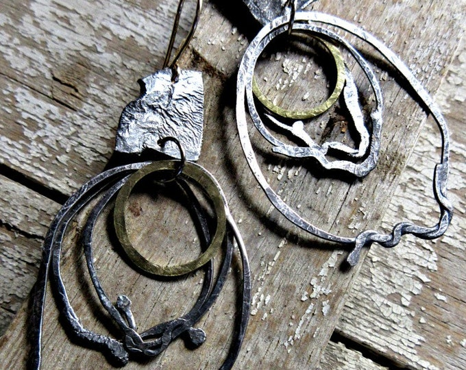 Layers of rustic melting looking silver with bronze ear wires and small bronze hammered center hoops make these a classy urban statement