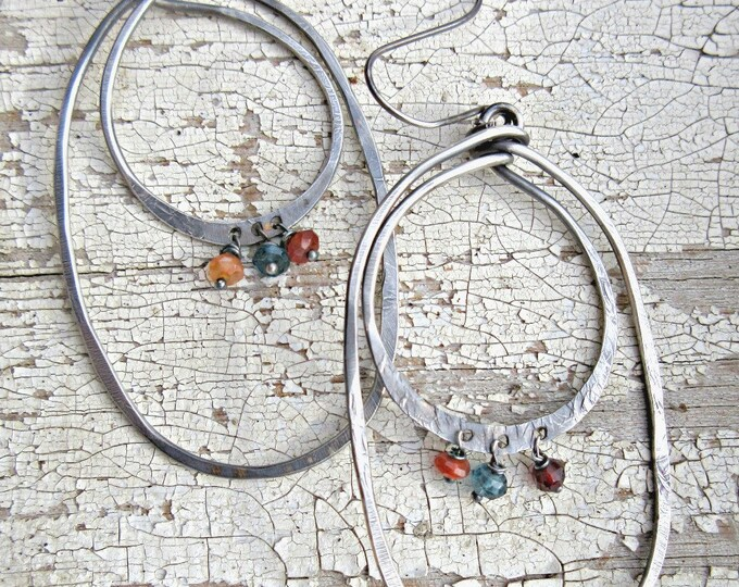 Large double hoop earrings with garnet, blue topaz, and carnelian semi-precious stones by Vintage PonyTM, artisan crafted in the USA