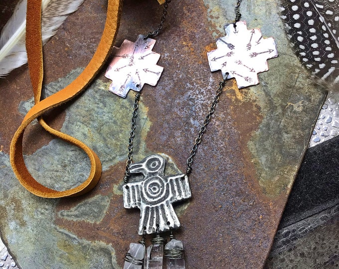 This thunderbird necklace lays just the way it should on the neckline, cowgirl chic,American west, western fashion