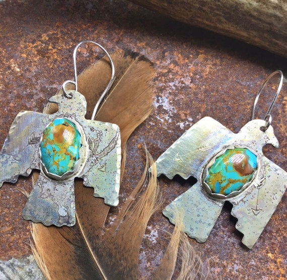 Thunderbird earrings with  Turquoise bezel set in sterling with sterling ear wires, aged purposefully, can be polished shiny