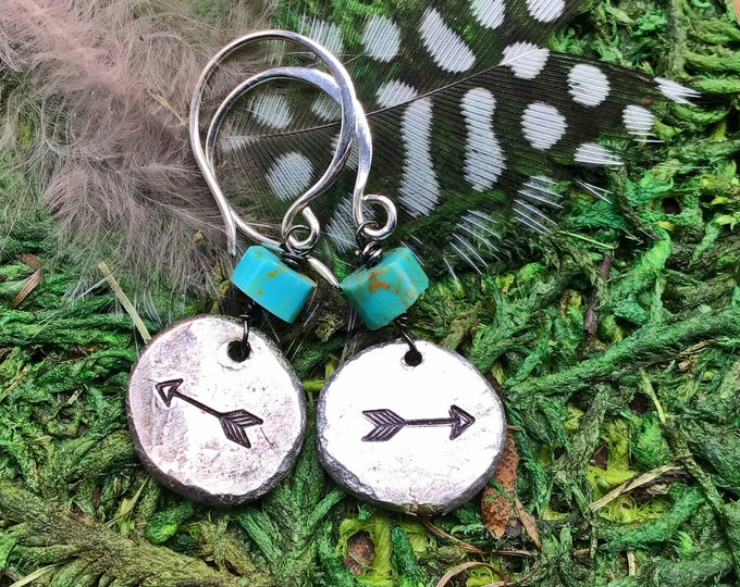 Itty bitty rustic arrow earrings by Weathered Soul, artisan sterling hammered discs with embossed arrows and a touch of turquoise to top off