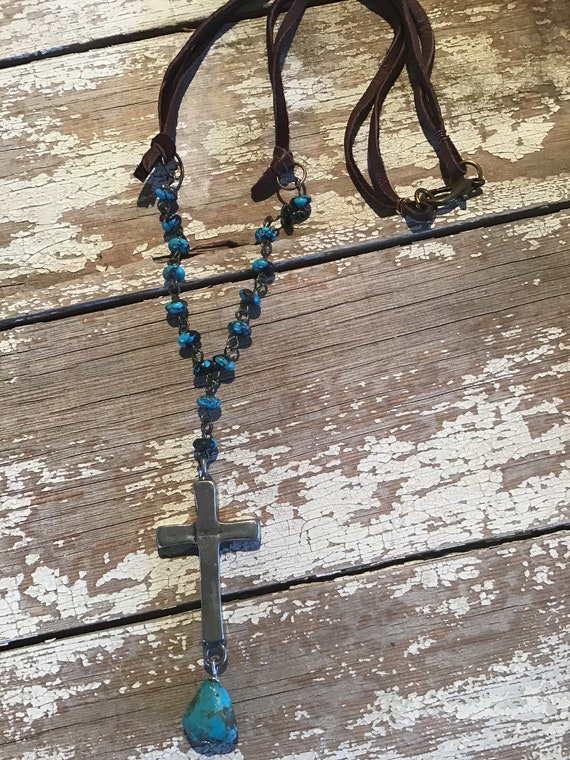 Cowgirl up cross necklace by Weathered Soul, wire wrapped tiny turquoise nuggets with larger nugget at bottom of cross with leather cord