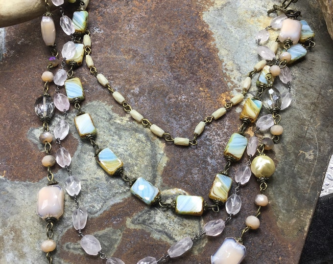 Vintage inspired chic with stunning layers of crystals, pink quartz, bronze big link chain, soft  muted tones