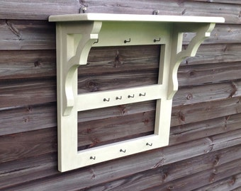 Victorian style painted kitchen utensil rack with top shelf