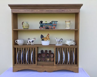Pine shelves incorporating a central  spoon rack and plate racks