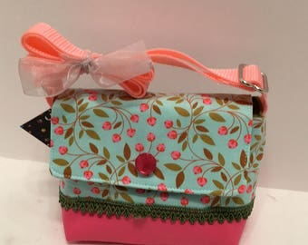 C76- Wee Bag: tiny blossoms on branches print on a blue background shoulder purse with adjustable handle