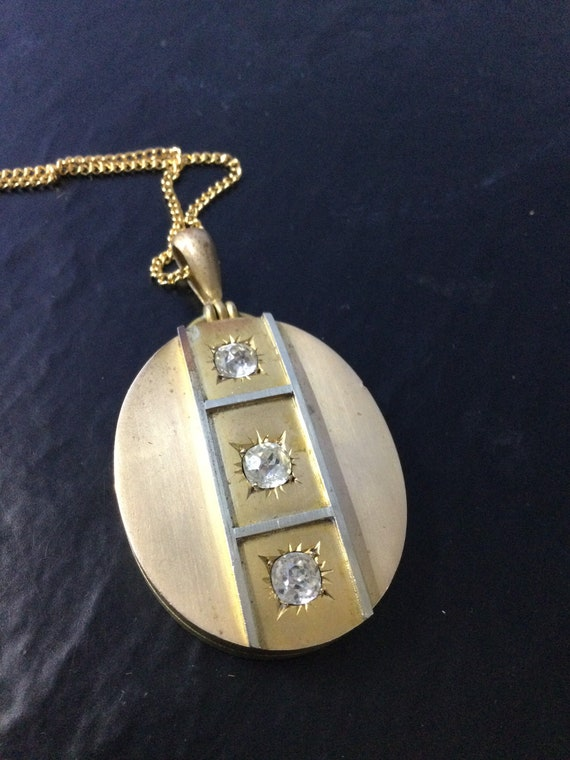 Victorian pinchbeck locket with stones